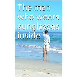 The man who wears sunglasses inside