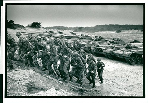 Vintage photo of Trooper Shane Blackburn of the 2nd Tank Reg walks the barrel of a Challenger tank during the rehearsals for Battle Day at Bovington. ()