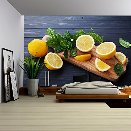 Lemon and Mint Leaves Served on Wooden Kitchen Board on Black Rustic Table