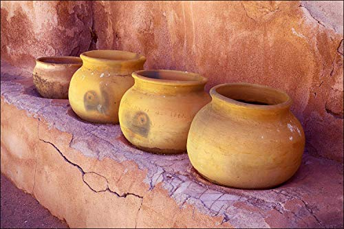 (Tumacacori ceramic pots at Southwest adobe walled Spanish mission in Arizona.)