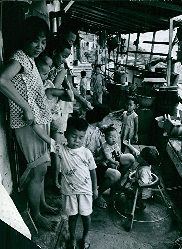 Vintage photo of Hong Kong people, also known as Hong Kongers or Hong Kongese, are people who originate from or live in Hong Kong.