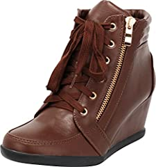 This fashion sneaker from Cambridge Select features a closed, round toe, lace-up closure (side zipper is superficial), padded footbed, padded collar, and wrapped wedge heel. Imported.