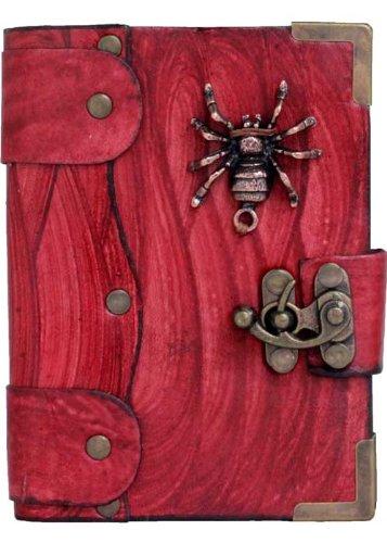 Chupetes araignée sur un diario en cuir rouge/carnet/bloc ...