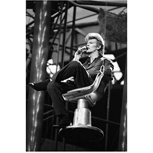 David Bowie performing in a suspended chair 8 x 10 Inch Photo