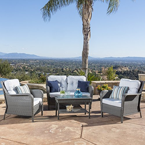 Haiden patio furniture 4 piece outdoor wicker conversation for Outdoor furniture 4 piece
