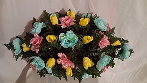 Cemetery-Saddle-Arrangement-Made-with-Yellow-Tulips-Pink-Butter-Cups-and-Pool-Blue-Peonies