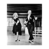 Fred Astaire in Black Pinstripe Pants and Suit Jacket Dancing with Ginger Rogers Holding Dress Above Knees 8 x 10 inch photo
