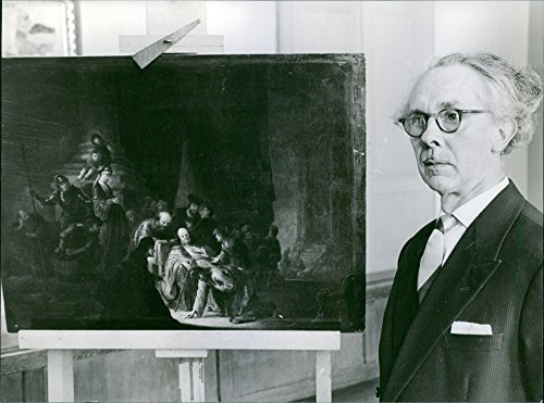 Vintage photo of Vintage photo of Rembrandt Harmenszoon van Rijn standing with his painting.