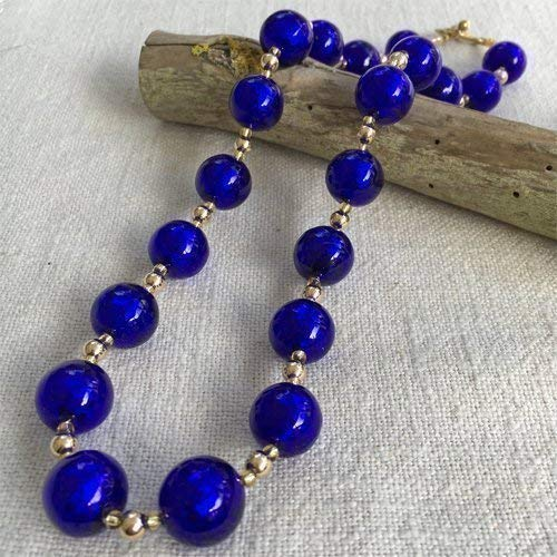 Diana Ingram Murano glass necklace with dark blue (cobalt) sphere beads (14mm) on gold findings.