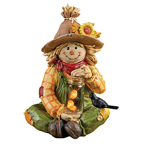 - Collections Etc Solar Smiling Scarecrow Fall Garden Statue That's Holding a Clear Jar with a String of Lighted Pumpkins