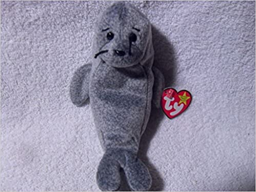 8bc495c26af Ty Beanie Baby ~ SLIPPERY the Seal ~ MINT with MINT TAGS ~ RETIRED  NONE   Amazon.com  Books