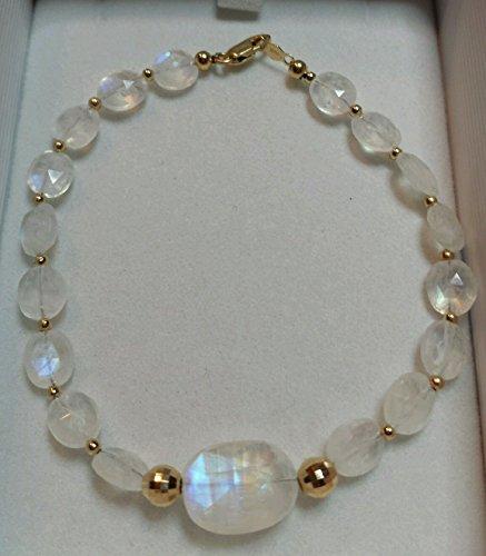 - 45cts super blue flash Moonstone oval faceted nuggets solid 14k gold bracelet