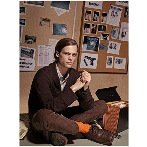 criminal-minds-8-x-10-photo-dr-spencer-reid-matthew-gray-gubler-sitting-cross-legged-on-desk-orange-