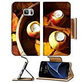 MSD Premium Samsung Galaxy S7 Flip Pu Leather Wallet Case Composition with apples and candles in tub on wooden background Image ID 24179120