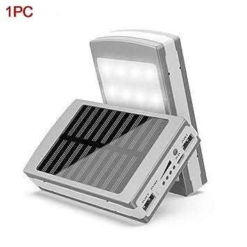 Cargador de batería Solar portátil para teléfono móvil de 15.000 mAh, Cargador Externo con Doble USB, Plata: Amazon.es: Deportes y aire libre