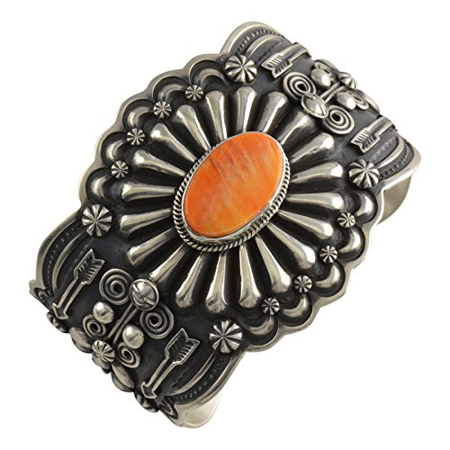 - Select Jewelry Displays Darrell Cadman Sterling Silver Spiny Oyster Repousse Arrows Cuff Navajo Bracelet