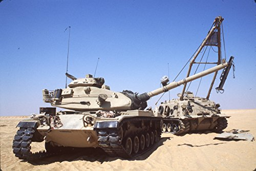 (Home Comforts Laminated Poster an M-88 Armored Recovery Vehicle is Used to Change The Engine of an M-60 Main Battle Tank During The Vivid Imagery Poster Print 24 x 36)