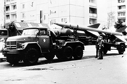 Home Comforts Laminated Poster Left Side View of an SA-2 Guideline Surface-to-air (SAM) Missile Mounted on a Zil-131 Transporter of Vivid Imagery Poster Print 24 x 36