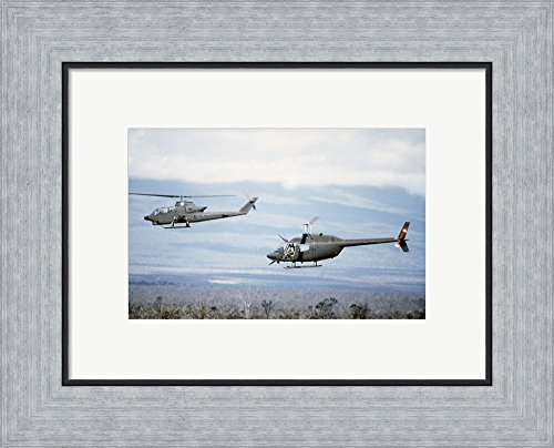 A left side view of an AH-1 Cobra helicopter, front, and an OH-58 Kiowa helicopter Framed Art Print Wall Picture, Flat Silver Frame, 16 x 13 inches (Helicopter Front)