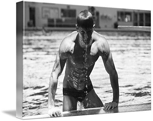Wall Art Print entitled Diver Pulling Himself Out Of Pool With Water Dripp by Design Pics | 24 x 16 - Blurred Out Costume
