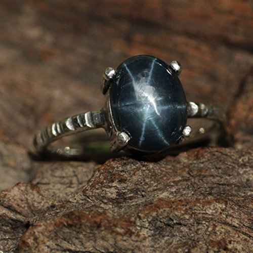 Sterling silver ring with oval star sapphire in silver prongs setting and textured band