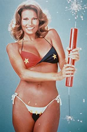 Raquel Welch 24x36 Poster holding huge firecracker in stars and