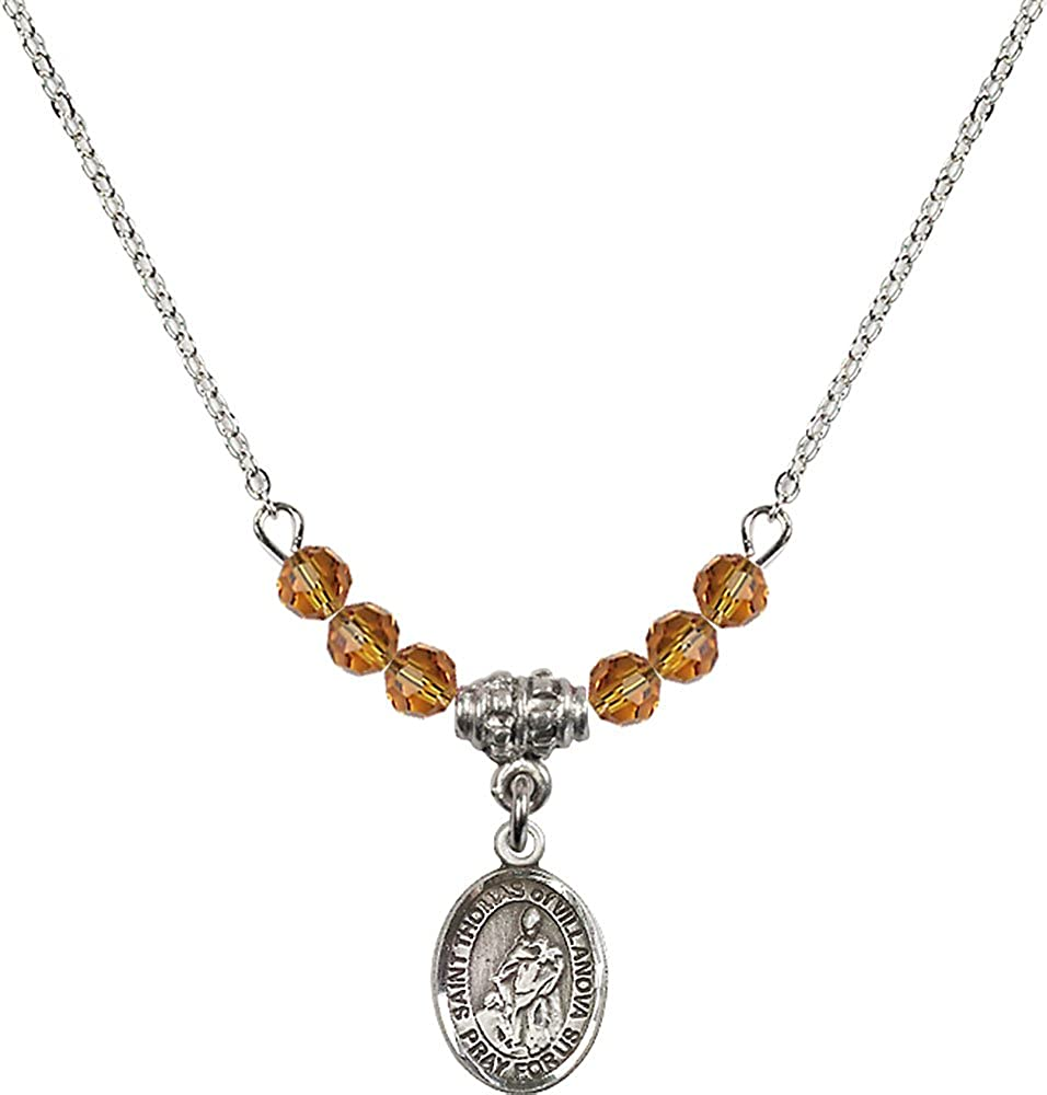 18-Inch Rhodium Plated Necklace with 4mm Topaz Birthstone Beads and Sterling Silver Saint Thomas of Villanova Charm.