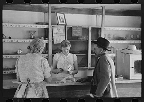Louis Stagg who runs the cafe and her mother looking at greeting cards which the salesman has. Pie Town, New - Louis Photograph