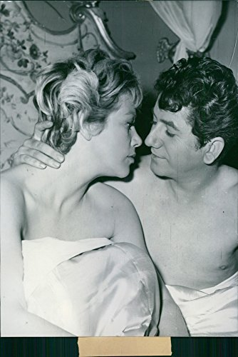 "Vintage photo of Daniel Gelin and Hildegard Knef in a scene from the 1958 movie,""La Fille de Hambourg""."
