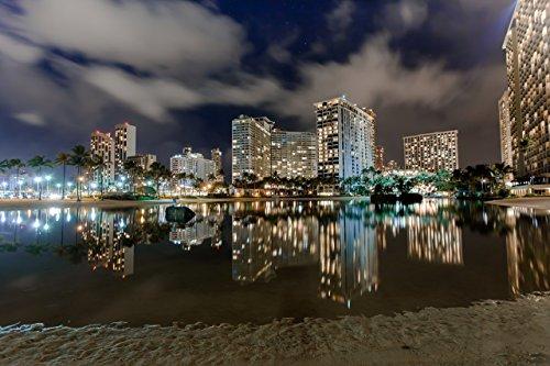 Hotels with lights reflecting off the water at night at Duke Kahanamoku Lagoon in Waikiki, Honolulu, Oahu, Hawaii print picture photo photograph fine art