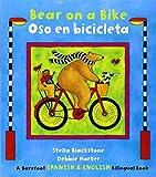 img - for Bear on a Bike/Oso En Bicicleta by Stella Blackstone (2014-08-01) book / textbook / text book
