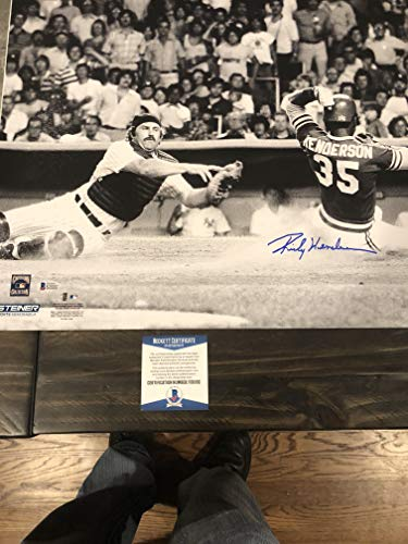 Henderson Autographs - Autographed Rickey Henderson 16x20 licensed photo sliding in on Thurman Munson Beckett certified signed