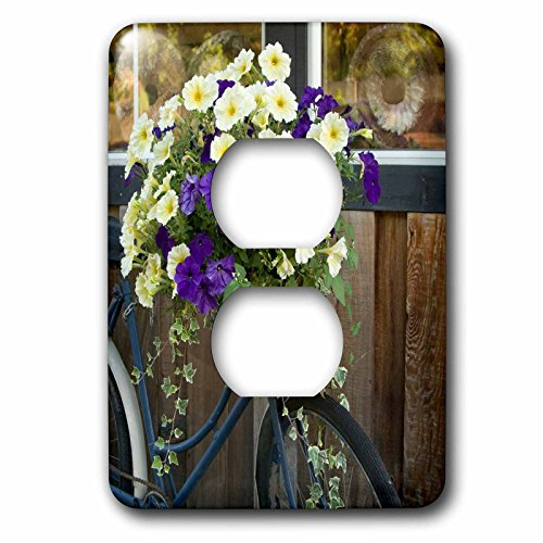 Danita Delimont - Canada - Vancouver Island. Flowers, bicycle in front of bakery, Cowichan Bay - Light Switch Covers - 2 plug outlet cover (lsp_226780_6)
