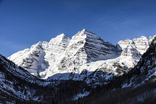 Maroon Bells (Aspen, CO Photo - Wintertime view of the twin Maroon Bells mountain peaks at one of the most photographed spots in the Rocky Mountain state of Colorado, outside the ski-resort town of Aspen.)