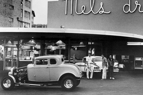 (American Graffiti Milner's '32 Ford Coupe & Toad's '58 Chevy Impala outside Mel's Diner 24x36 Poster)
