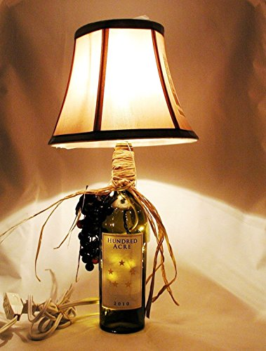 - Beautiful High End Table Lamp For a Wine Connoisseur. Two-Way Lamp/Night Light crafted from a recycled Hundred Acre 2010 Ark Vineyard Cabernet wine bottle. Shipping is included.