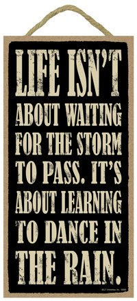(SJT94106) Life isn't about waiting for the storm to pass. It's about learning to Dance In The Rain. 5'' x 10'' wood sign plaque