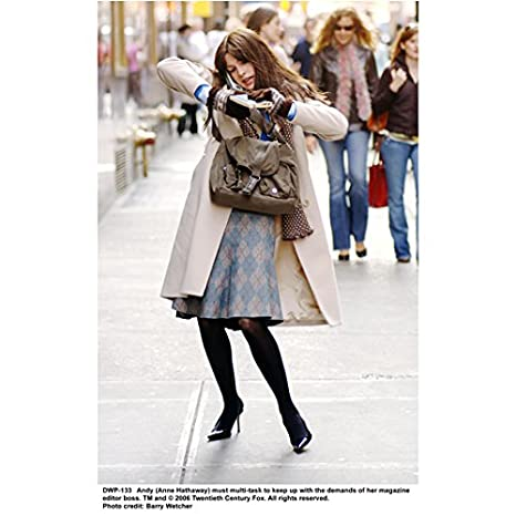 4288c022b6a6 The Devil Wears Prada 8x10 Photo Anne Hathaway Struggling w/Purse &  Telephone on Sidewalk kn at Amazon's Entertainment Collectibles Store