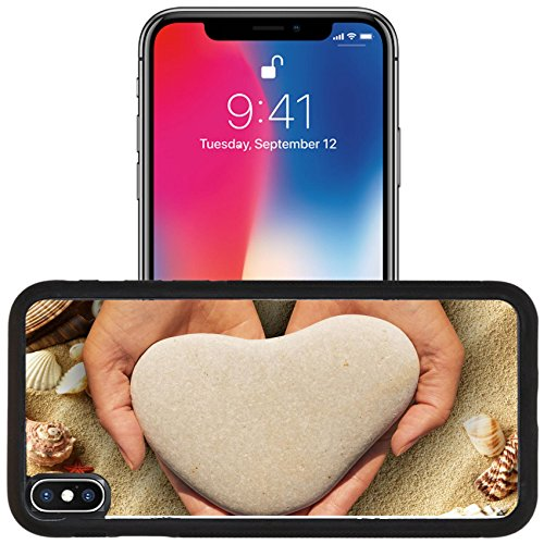 Luxlady Apple iPhone x iPhone 10 Aluminum Backplate Bumper Snap Case IMAGE ID: 30273086 Female hands holding a natural heart shaped stone in cupped palms over a background of shells (Shaped Jet Stone)