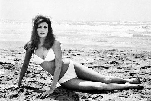 Raquel Welch lying on beach in bikini barefoot b/w 11x17 Mini Poster by Silverscreen
