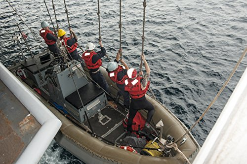 Home Comforts Sailors Climb Monkey Lines as a Rigid Hull Inflatable Boat is Lowered into The Water During Small-bo