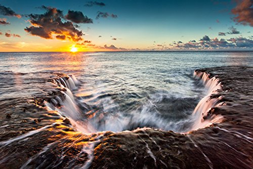 water-cascading-off-of-a-rocky-shelf-under-a-golden-sunset-at-sharks-cove-north-shore-oahu-hawaii-pr