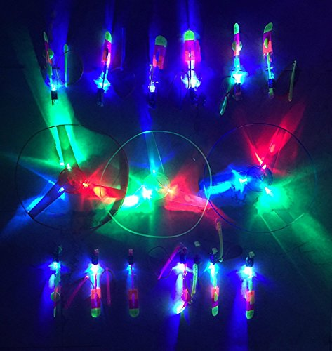30 Pieces Flying LED Light Up Toy Party Pack - 12 Pcs Changing Color Led Light Arrow Rocket copters +15 Pcs Light Up Flying Sling shot Arrow Rocket + 3Pcs Light Up Flying Saucer UFO With Hand Launcher