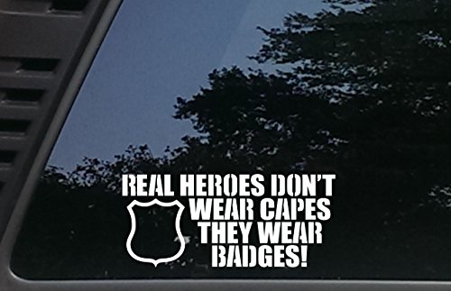 Real Heroes Don't Wear Capes They Wear BADGES - 8 inches by 3 1/2 inches die cut vinyl decal for cars, trucks, windows, boats, tool boxes, laptops - virtually any hard smooth surface