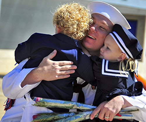 Home Comforts A Sailor assigned to the littoral combat ship USS Freedom (LCS 1) greets his children during a home by Home Comforts