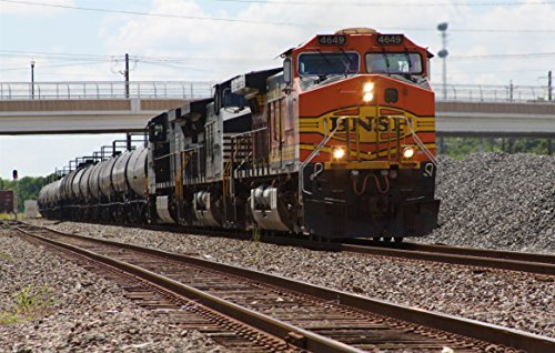 Home Comforts Laminated Poster Eastbound BNSF Manifest at Rosenberg Texas. Led by BNSF #4649 (GE Dash 9-44CW) and 2 Norfolk Souther Vivid Imagery Poster Print 24 x 36