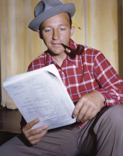 Bing Crosby smoking pipe reading script 8x10 Promotional Photograph