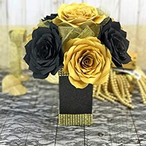 Gold and black centerpiece with paper filter flowers 98