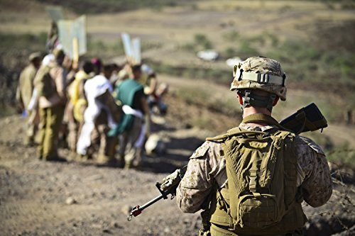 A U.S. Marine watches a group of mock protestors during an
