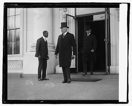 1922 November 21. Photo Harding & Christian leaving W.H., 11/21/22 by Historic Photos
